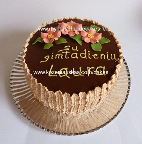 Honey cake with fresh whipped cream. Chocolate and cream decorations ...