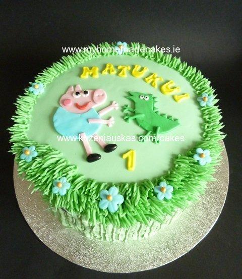 George and dinosaur cake